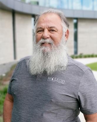 Man in gray shirt smiling